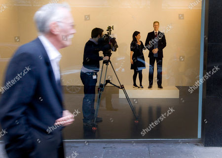 Prince William A passerby walks past as a gallery worker is filmed, standing next to life-sized wax statue of Prince William, right, as visitors to the Stephen Friedman Gallery in Mayfair are invited to stand next to the statue created by American artist Jennifer Rubell, to 'step into the shoes of Kate Middleton', in London