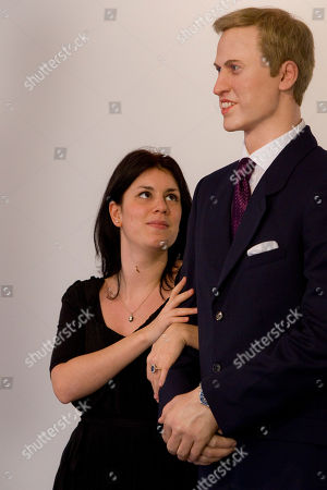 Prince William A gallery worker stands next to a life-sized wax statue of Prince William and puts her finger through a replica of the sapphire and diamond ring, made famous by Lady Diana, as visitors to the Stephen Friedman Gallery in Mayfair are invited to stand next to the statue created by American artist Jennifer Rubell, to 'step into the shoes of Kate Middleton', in London