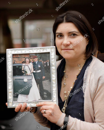 Stock Photo of Kate Middleton poses for photographs with a framed picture of her wedding day to Mark Middleton, who was at that time serving in the military as a paratrooper, at her home in Pembury, England, . It's not easy being Kate Middleton, just one of the many women who share the name of the woman who is soon to marry Britain's Prince William. This Kate Middleton is a teacher, was born Kate Elizabeth Walker and hadn't even heard of Prince William's romance when she married Mark Middleton on April 17, 2004