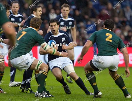 Scotland's Hugo Southwell, centre, runs into South Africa's Juan Smith, left, and Bismarck du Plessis, right, during the international rugby match between Scotland and South Africa at Murrayfield Stadium in Edinburgh, Scotland