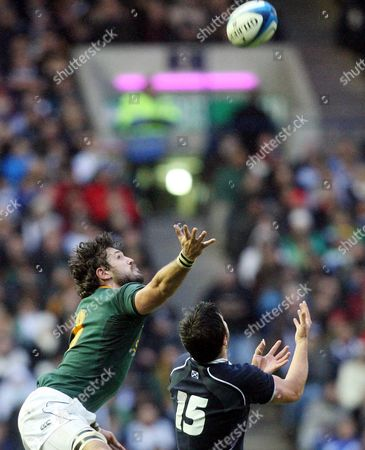 South Africa's Ryan Kankowski, left, is tackled by Scotland's Hugo Southwell, right, during the international rugby match at Murrayfield, Edinburgh, Scotland