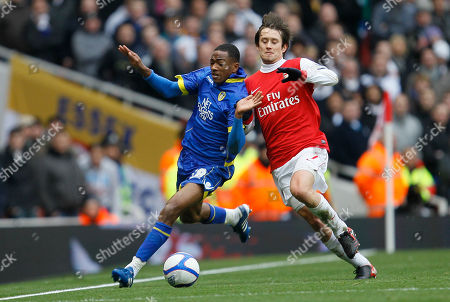 Arsenal's Tomas Rosicky, right fouls Leeds United's Sanchez Watt, during their English FA Cup third round soccer match at Arsenal's Emirates stadium in London Saturday, Jan, 8 2011 . (AP Photo/Alastair Grant) ** NO INTERNET/MOBILE USAGE WITHOUT FOOTBALL ASSOCIATION PREMIER LEAGUE(FAPL)LICENCE. CALL +44