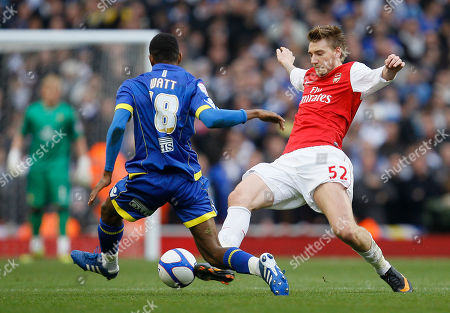 Arsenal's Nicklas Bendtner, right, goes for the ball with Leeds United's Sanchez Watt during their English FA Cup third round soccer match at Arsenal's Emirates stadium in London Saturday, Jan, 8 2011 . (AP Photo/Alastair Grant) ** NO INTERNET/MOBILE USAGE WITHOUT FOOTBALL ASSOCIATION PREMIER LEAGUE(FAPL)LICENCE. CALL +44