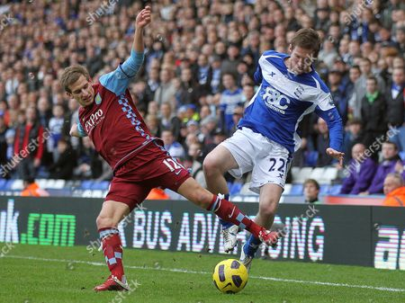 Birmingham City's Alexander Hleb, right, competes for the ball with Aston Villa's Marc Albrighton during their English Premier League soccer match at St' Andrews stadium, Birmingham, England, . (AP Photo/Simon Dawson) NO INTERNET/MOBILE USAGE WITHOUT FOOTBALL ASSOCIATION PREMIER LEAGUE (FAPL) LICENCE. CALL +44