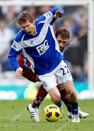 Birmingham City's Alexander Hleb, forward, competes for the ball with Aston Villa's Stiliyan Petrov during their English Premier League soccer match at St Andrews stadium, Birmingham, England, . (AP Photo/Simon Dawson) NO INTERNET/MOBILE USAGE WITHOUT FOOTBALL ASSOCIATION PREMIER LEAGUE (FAPL) LICENCE. CALL +44