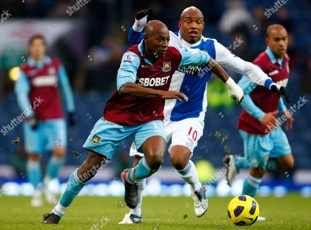 Luis Boa Morte, El-Hadji Diouf Blackburn's El-Hadji Diouf, second right, vies for the ball against West Ham's Luis Boa Morte during their English Premier League soccer match at Ewood Park, Blackburn, England, . (AP Photo/Tim Hales) NO INTERNET/MOBILE USAGE WITHOUT FOOTBALL ASSOCIATION PREMIER LEAGUE (FAPL) LICENCE. CALL +44