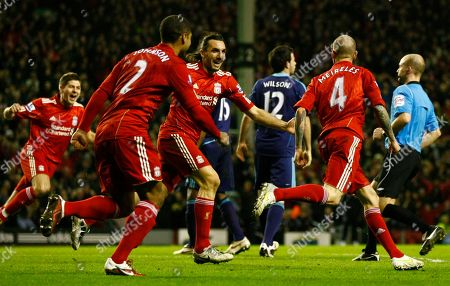 Raul Meireles, Sotirios Kyrgiakos Liverpool's Raul Meireles, right, is congratulated by team mates after scoring a goal against Stoke City during their English Premier League soccer match at Anfield, Liverpool, England, . (AP Photo/Tim Hales) NO INTERNET/MOBILE USAGE WITHOUT FOOTBALL ASSOCIATION PREMIER LEAGUE (FAPL) LICENCE. CALL +44