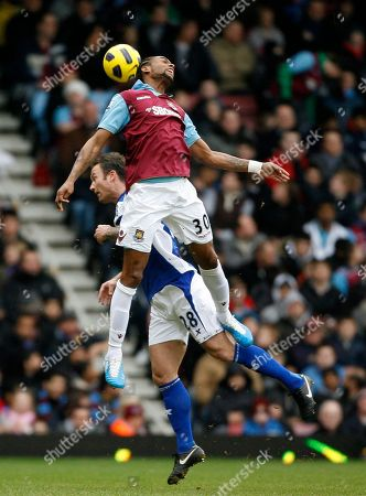 West Ham United's Frederic Piquionne, top, and Birmingham City's Martin Jiranek vies for the ball during their English Premier League soccer match at Upton Park in London, . (AP Photo/Akira Suemori) NO INTERNET/MOBILE USAGE WITHOUT FOOTBALL ASSOCIATION PREMIER LEAGUE(FAPL)LICENCE. CALL +44