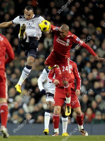 Tottenham Hotspur's Younes Kaboul, left, and Liverpool's David N' Gog, right, fight for the ball during their English Premier League soccer match at the White Hart Lane ground in London, . Tottenham won the match 2-1. (AP Photo/Lefteris Pitarakis) NO INTERNET/MOBILE USAGE WITHOUT FOOTBALL ASSOCIATION PREMIER LEAGUE (FAPL) LICENCE - CALL +44