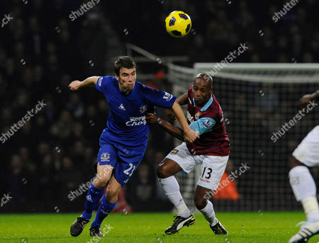 Luis Boa Morte, Seamus Coleman West Ham United's Luis Boa Morte, right, fights for the ball with Everton's Seamus Coleman during their English Premier League soccer match at Upton Park stadium, London, . (AP Photo/Tom Hevezi) NO INTERNET/MOBILE USAGE WITHOUT FOOTBALL ASSOCIATION PREMIER LEAGUE(FAPL)LICENCE. CALL +44