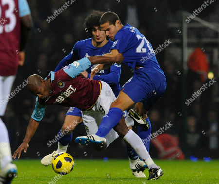 Luis Boa Morte, Jack Rodwell West Ham United's Luis Boa Morte, left, is tackled by Everton's Jack Rodwell during their English Premier League soccer match at Upton Park stadium, London, . (AP Photo/Tom Hevezi) ** NO INTERNET/MOBILE USAGE WITHOUT FOOTBALL ASSOCIATION PREMIER LEAGUE(FAPL)LICENCE. CALL +44