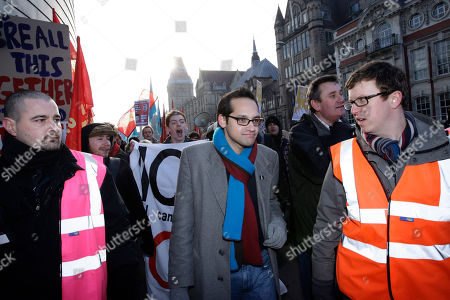 President of the National Union of Students Aaron Porter, centre, is lead away from a a rally against government spending cuts after a hostile reception, Manchester, England, . Scuffles later broke out in central Manchester between protesters and police