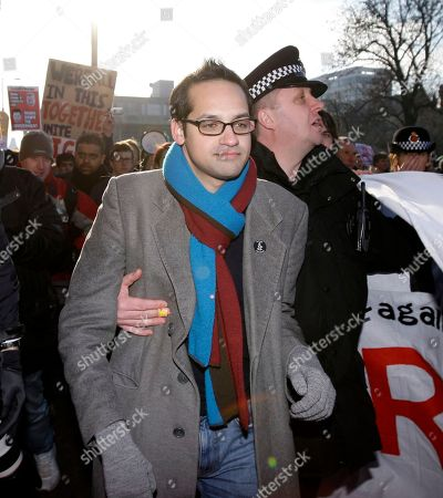 Stock Photo of President of the National Union of Students Aaron Porter, centre, is escorted away by police after a hostile reception by demonstrators from a rally against government spending cuts, Manchester, England, . Scuffles later broke out in central Manchester between protesters and police
