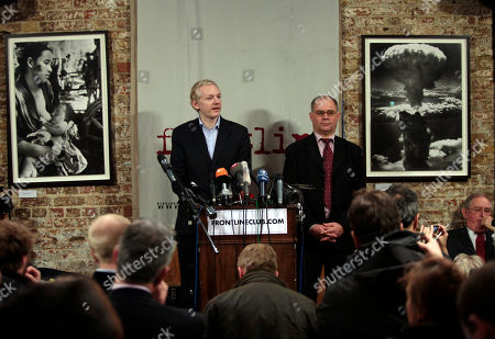 WikiLeaks founder Julian Assange, left, accompanied by Rudolf Elmer, right, answers questions during a news conference at the Frontline Club in London, . Elmer blew the whistle on the conduct of Julius Baer Bank in the Cayman Islands for which he is set to stand trial in Zurich, Switzerland, on Jan. 19 for breaching Swiss bank secrecy laws. Elmer claims he has evidence of alleged abuses in the world of offshore financial centres and passed the said documents and information to Wikileaks