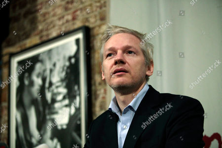 Julian Assange WikiLeaks founder Julian Assange, answers a reporter's question during a joint news conference with Rudolf Elmer, not seen, at the Frontline Club in London, . Rudolf Elmer blew the whistle on the conduct of Julius Baer Bank in the Cayman Islands for which he is set to stand trial in Zurich, Switzerland, on Jan. 19 for breaching Swiss bank secrecy laws. Elmer claims he has evidence of alleged abuses in the world of offshore financial centres and passed the said documents and information to Assange