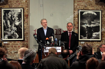 WikiLeaks founder Julian Assange, left, accompanied by former Swiss banker Rudolf Elmer, right, answers questions during a news conference at the Frontline Club in London, . Elmer blew the whistle on the conduct of Julius Baer Bank in the Cayman Islands for which he is set to stand trial in Zurich, Switzerland, on Jan. 19 for breaching Swiss bank secrecy laws. Elmer claims he has evidence of alleged abuses in the world of offshore financial centres and passed the said documents and information to Wikileaks