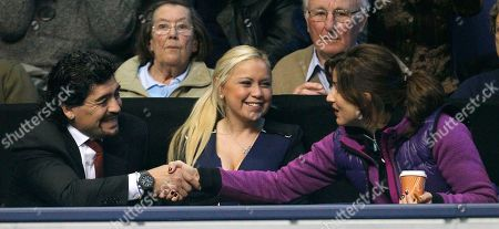 Diego Maradona, Veronica Odejaduring, Miroslava Vavrinec Argentinian soccer legend Diego Maradona, left, with friend Veronica Odeja, centre, shakes hand with Miroslava Vavrinec, wife of Roger Federer as they watch the men's singles round robin match between Robin Soderling of Sweden and Switzerland's Roger Federer at the ATP World Tour Finals tennis tournament at the O2 Arena, in London, Thursday, Nov. 25. 2010