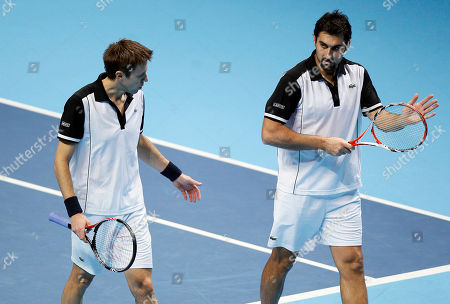 Nenad Zimonjic, Daniel Nestor Serbia's Nenad Zimonjic, right, and Canada's Daniel Nestor talk during a round robin doubles tennis match against South Africa's Wesley Moodie and Belgium's Dick Norman at the ATP World Tour Finals at the O2 Arena in London