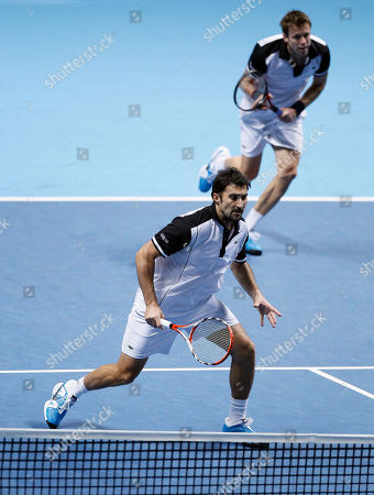 Nenad Zimonjic, Daniel Nestor Serbia's Nenad Zimonjic, front, and Canada's Daniel Nestor play a return during a round robin doubles tennis match against South Africa's Wesley Moodie and Belgium's Dick Norman at the ATP World Tour Finals at the O2 Arena in London