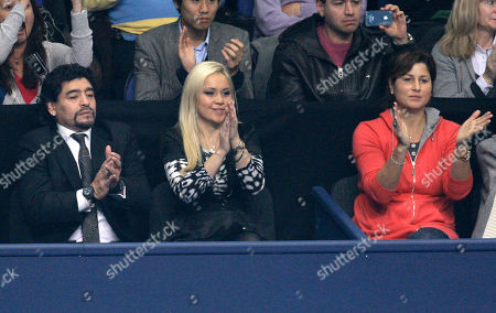 Diego Maradona, Veronica Odeja, Miroslava Vavrinec Argentinian soccer legend Diego Maradona, left, his friend Veronica Odeja, center, and Roger Federer's wife Miroslava Vavrinec, right, applaud as Switzerland's Roger Federer and Britain's Andy Murray prepare to start their round robin single tennis match of the ATP World Tour Finals at O2 Arena in London