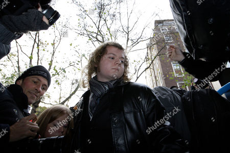 Edward Woollard Student Edward Woollard, center, arrives at City of Westminster Magistrates' Court in London for his second hearing on accusation of throwing a fire extinguisher at police from a rooftop during the Millbank riot in London,in which students protested against tuition fee rises proposed by the government