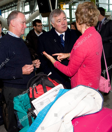 Sir Nigel Rudd, centre, Chairman of the British Airport Authority talks to passengers at Heathrow's Terminal 5 in London . Major delays and cancellations persisted Tuesday at European airports including London's Heathrow, and on the Eurostar train link, leaving thousands stranded across Europe as Christmas approached