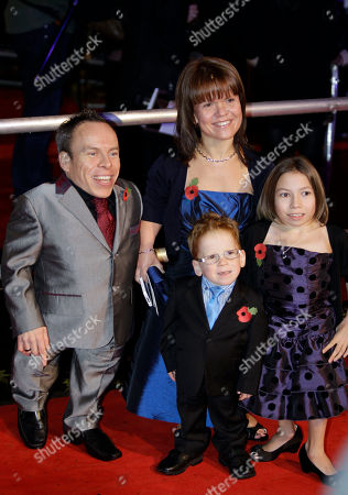 British actor Warwick Davis, left, his wife, Samantha Davis and their children, Annabel Davis and Harrison Davis attend the world premiere of the film' Harry Potter and The Deathly Hallows', at a cinema in central London