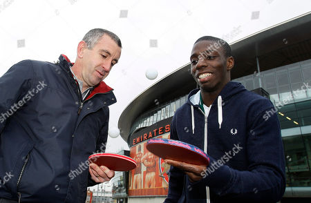 Nigel Winterburn, Darius Knight Former Arsenal soccer player Nigel Winterburn, left, meets table tennis champion Darius Knight, right, at Arsenal's Emirates Stadium in London, ahead of the Urban Cup competition, . There's a new cup competition involving the Premier League in town, and the trophy will be held aloft by a team of inner city kids who play table tennis. The Urban Cup is a ping pong tournament aimed at getting underprivileged kids off the streets and involved in the sport, and this year's event is going to feature Manchester United, Arsenal, Chelsea and the rest of the Premier League teams