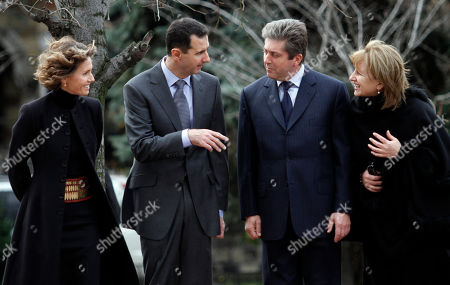The wife of Syrian President, Asma Al-Assad, left to right, Syrian President Bashar al-Assad, Bulgarian President Georgi Parvanov and his wife Zorka Parvanova talk before the review of Bulgarian army honour guard during the official welcome ceremony at the Tomb of the Unknown soldier, in Sofia on . Assad is on a one-day official visit, which is the first visit to the country by a Syrian head of state in the past 24 years