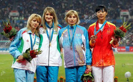 From left, Nadiya Dusanova, of Uzbekistan, silver, Uzbekistan's Svetlana Radzivil, Kazakhstan's Anna Ustinova, bronze, and China's Zheng Xingjuan, bronze, during the medal ceremony for the women's high jump, at the 16th Asian Games in Guangzhou, China