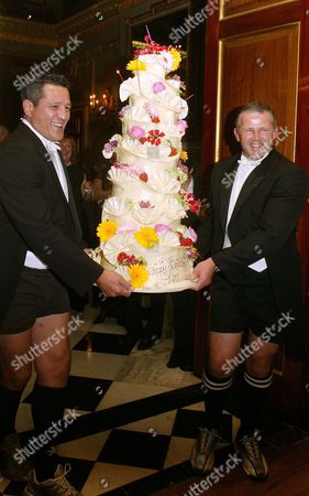 Zinzan Brooke and Sean Fitzpatrick bring in the birthday cake