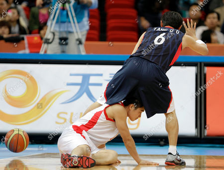 North Korea's Kye Kwang Yu, bottom, and South Korea's Yang Dong-geun collide during their men's basketball match at the Asian Games in Guangzhou, China