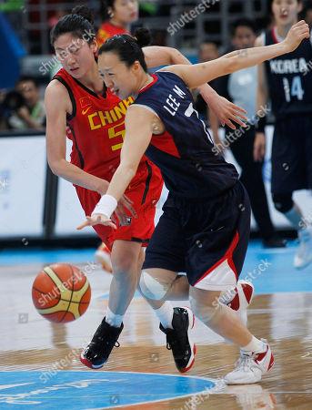 Bian Lan, Lee Mi Sun China's Bian Lan, left, battles the ball with South Korea's Lee Mi Sun during the final match of women's basketball at the 16th Asian Games in Guangzhou, China