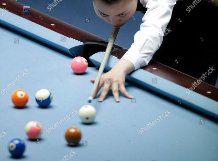 China's Liu Shasha plays during a semi-final match for women's 8-ball pool singles against Taiwan's Chang Shu Han at the 16th Asian Games in Guangzhou, China, . Liu won 5-3