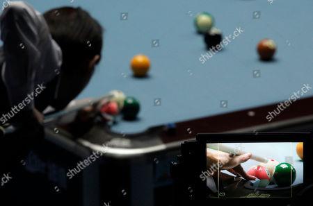 Taiwan's Chang Shu Han plays during a semi-final match against China's Liu Shasha, unseen, in the women's 8-ball pool singles at the 16th Asian Games in Guangzhou, China, . Liu won 5-3