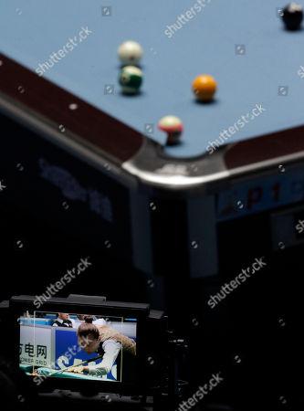 China's Liu Shasha is seen on a camera screen during a semi-final match against Taiwan's Chang Shu Han, unseen, in the women's 8-ball pool singles at the 16th Asian Games in Guangzhou, China, . Liu wins 5-3
