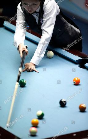 Taiwan's Chang Shu Han plays during a semi-final match in the women's 8-ball pool singles against China's Liu Shasha, unseen, at the 16th Asian Games in Guangzhou, China, . Liu wins 5-3