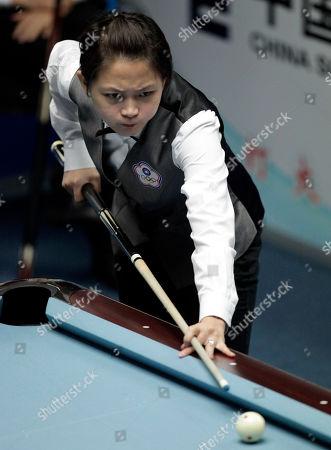 Taiwan's Chang Shu Han plays during a semi-final match in the women's 8-ball pool singles against China's Liu Shasha, unseen, at the 16th Asian Games in Guangzhou, China, . Liu won 5-3