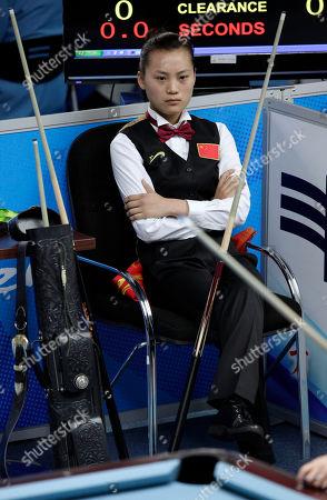 China's Liu Shasha waits her turn against Taiwan's Chang Shu Han, unseen, during a semi-final match in the women's 8-ball pool singles at the 16th Asian Games in Guangzhou, China, . Liu won 5-3
