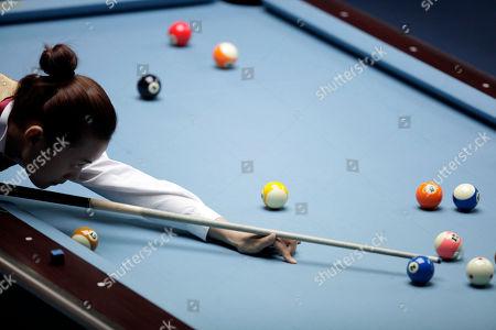 China's Liu Shasha lines up a shot during a semi-final match against Taiwan's Chang Shu Han, unseen, in the women's 8-ball pool singles at the 16th Asian Games in Guangzhou, China, . Liu wins 5-3