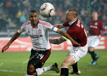 Tomas Repka, David Ngog David Ngog, left, from Liverpool fights for a ball with Tomas Repka, right, from Sparta Prague during their first leg round of 32 Europa League soccer match in Prague, Czech Republic, . Liverpool tied with Sparta 0-0