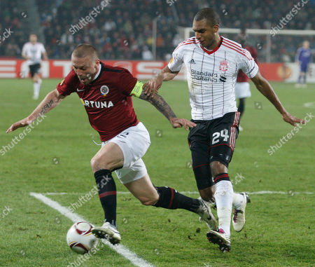 Tomas Repka, David Ngog David Ngog, right, from Liverpool fights for a ball with Tomas Repka, left, from Sparta Prague during their first leg round of 32 Europa League soccer match in Prague, Czech Republic
