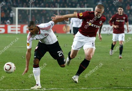 Tomas Repka, David Ngog David Ngog, left, from Liverpool challenges for a ball with Tomas Repka, right, from Sparta Prague during their first leg round of 32 Europa League soccer match in Prague, Czech Republic