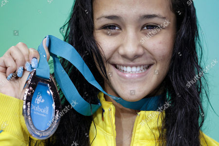 Australia's Kotuku Ngawati shows off her silver medal for the Womens 100m Individual Medley final at the FINA Short Course Swimming World Championships in Dubai, United Arab Emirates