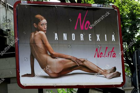 Stock Photo of Anorexia billboard campaign by fashion brand Nolita featuring Isabelle Caro, being shown in Italian cities