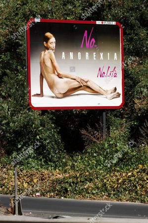 Stock Image of Anorexia billboard campaign by fashion brand Nolita featuring Isabelle Caro, being shown in Italian cities