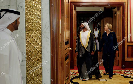 U.S. Secretary of States, Hillary Rodham Clinton, right, leaves the Zabeel Palace after her meeting with Sheikh Mohammad bin Rashid Al Maktoum, UAE Prime Minister and ruler of Dubai, centre left, in Dubai, United Arab Emirates