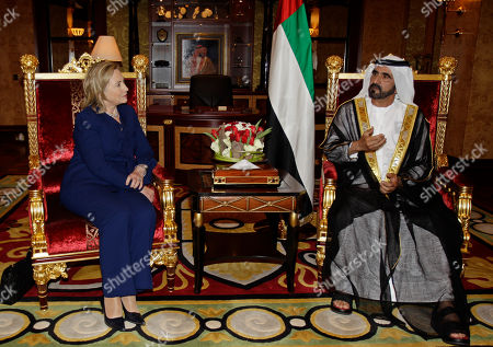 U.S. Secretary of State, Hillary Rodham Clinton, left, talks to Sheikh Mohammad bin Rashid Al Maktoum, UAE Prime Minister and ruler of Dubai, in his palace in Dubai, United Arab Emirates, . Clinton said Monday that sanctions have slowed Iran's efforts to develop atomic weapons and accused the country of trying to foment new conflict in the Middle East to distract attention from its nuclear ambitions. On the first stop of a three-nation tour of the Persian Gulf, Clinton said the Arab world in particular should act to sharpen enforcement of the sanctions and reject attempts to stoke Mideast tensions