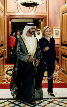 U.S. Secretary of States, Hillary Rodham Clinton, right, leaves the Zabeel Palace after her meeting with Sheikh Mohammad bin Rashid Al Maktoum, UAE Prime Minister and ruler of Dubai, left, in Dubai, United Arab Emirates