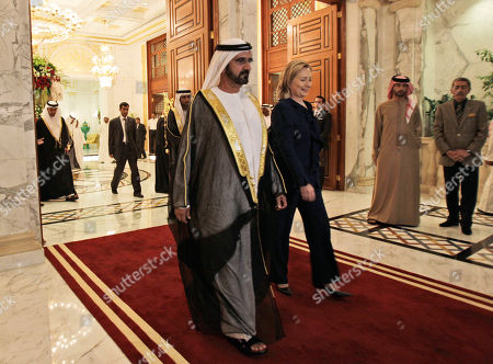 U.S. Secretary of States, Hillary Rodham Clinton, centre right, leaves the Zabeel Palace after her meeting with Sheikh Mohammad bin Rashid Al Maktoum, UAE Prime Minister and ruler of Dubai, front left, in Dubai, United Arab Emirates